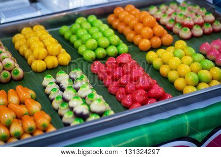 Sweet Bean Confections is a kind of dessert. Made from sweet bean, soaked with natural food colouring. Sweet taste. In Thai, it's called 'Look Choop'.