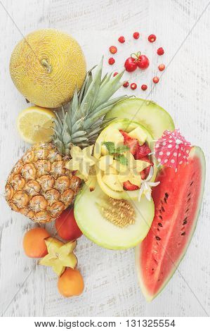 Summer fruit background. Still life with summer fruit on rustic table. Top view, blank space