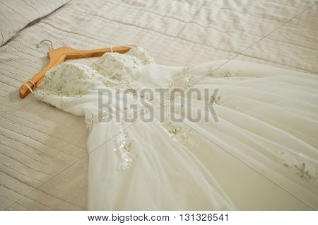 wedding dress are placed on the bed preparations for the wedding