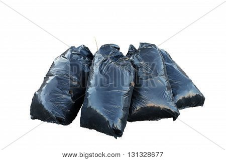 black garbarge bags with dry leaves isolated on white background