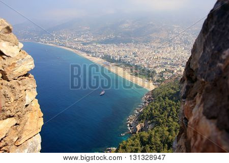 panoramic view over turkish Alanya city and Mediterranean sea from birds eye view from mountain fortress