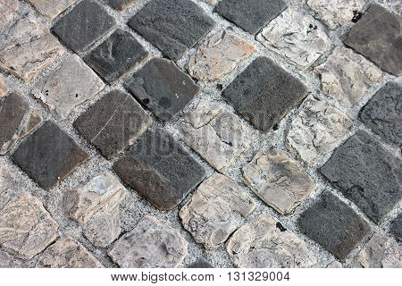 Ancient roman dilapidated small square stone paving in Rimini Italy