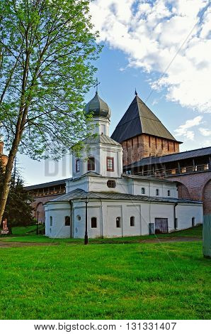 Architectural ensemble of Church of the Intercession and the Tower of intercession of the Novgorod Kremlin in Veliky Novgorod Russia at summer sunset