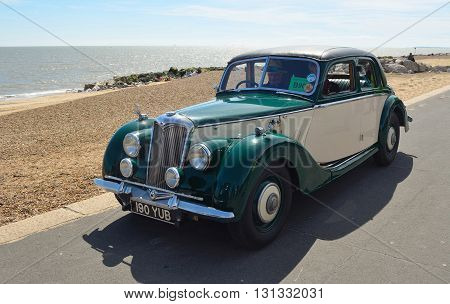 Felixstowe, Suffolk, England - May 01, 2016: Vintage Green and Cream Riley Motor Car parked on seafront promenade.