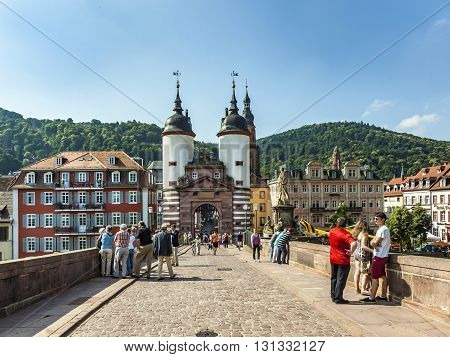 People Visit Old Bridge And Town Gate  In Heidelberg