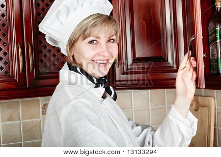 Cook woman cooking on the kitchen