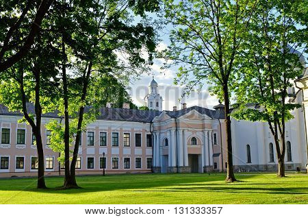 Architectural spring landscape - Novgorod Kremlin park with Clock Tower of Sophia Cathedral framed by trees in Veliky Novgorod Russia