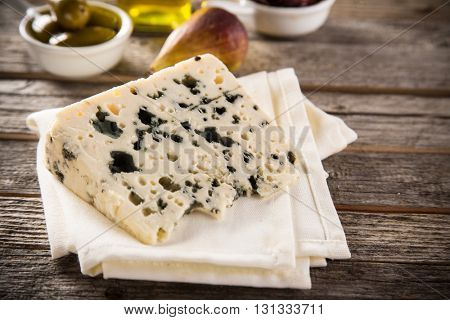 Delicious blue cheese on old wooden table