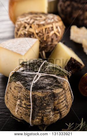 Delicious various cheese on black stone table
