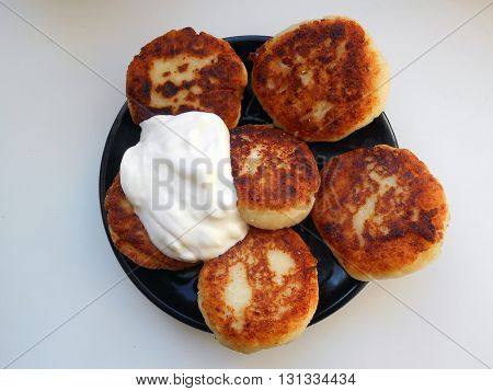 cottage cheese fritters  — a dish of Belarusian cuisine. cottage cheese fritters  are fried cottage cheese , mixed with flour and eggs