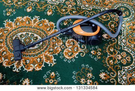 carpet vacuuming with vacuum cleaner at home. Parts of vacuum cleaner