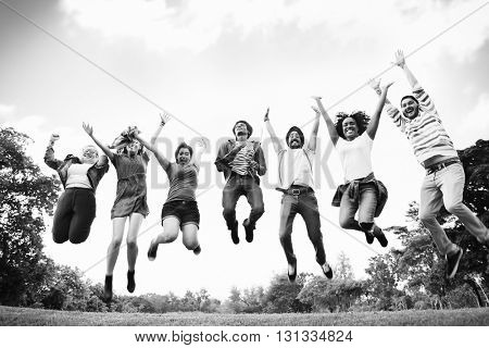 People Friendship Celebration Arms Outstretched Jumping Concept