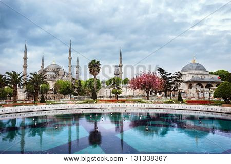 Aya Sofia Mosque for trees under cloudy sky. Istanbul, Turkey.