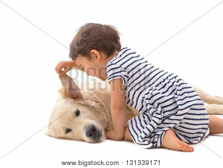 little girl whispering to her dog isolated