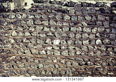 gray old stones wall background for design