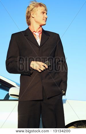 Business background: handsome businessman in a work process.