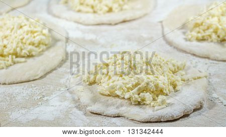 Cooking of fresh homemade delicious dumplings (varenyky) with cheese.