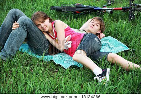 Beautiful couple lying on the grass