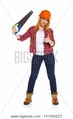Young funny woman worker in helmet with a saw on a white background