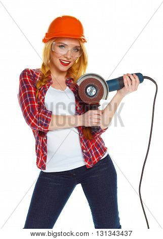 Female construction worker in a hard hat with angle grinder over white background