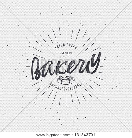 Bakery. Handwritten inscription. Hand drawn written in calligraphy, geometric elements used, rays, texture, stylized as a logo