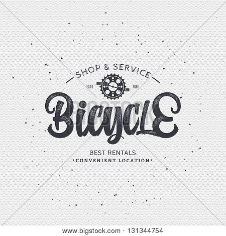 Bicycle badge insignia, monochrome using geometric shapes assembled in typographic elements on textured background worn paper