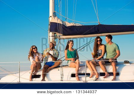 Men and women on yacht. Smiling people with drinks. Share your happiness. Piece of paradise.