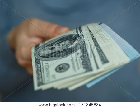 Woman hand with dollar bills in her hand