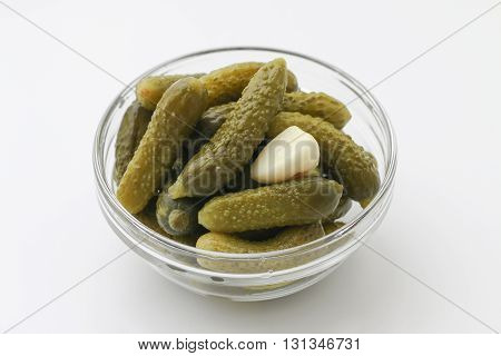 Marinated pickled cucumbers with garlic. Glass bowl of pickled gherkins. Pickled cucumbers.