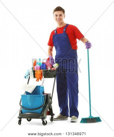 Young janitor with cleaner cart, isolated on white