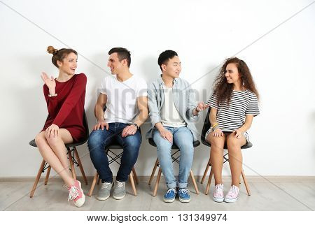 Group of people waiting for interview indoors