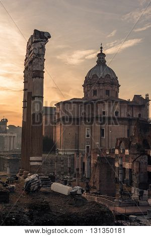 Rome, Italy: The Roman Forum, Latin: Forum Romanum, Italian: Foro Romano, in the sunrise. Santi Luca e Martina Church