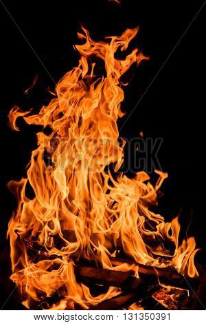 Orange fire flames isolated on black background.