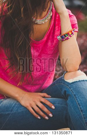 young urban woman with colorful summer bracelets