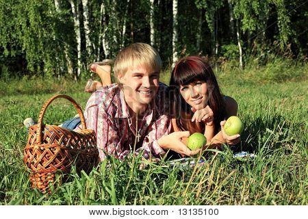 Beautiful couple lying on the grass