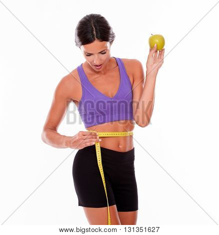 Healthy Measuring Woman With An Apple