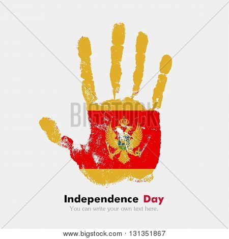 Hand print, which bears the Flag of Montenegro. Independence Day. Grunge style. Grungy hand print with the flag. Hand print and five fingers. Used as an icon, card, greeting, printed materials.