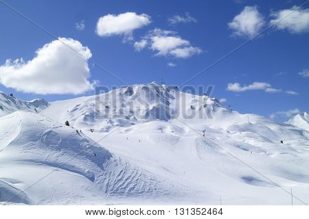 High French Alps mountain range panorama view with ski slopes in La Plagne resort