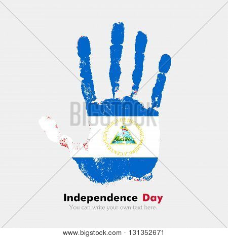 Hand print, which bears the Flag of Nicaragua. Independence Day. Grunge style. Grungy hand print with the flag. Hand print and five fingers. Used as an icon, card, greeting, printed materials.