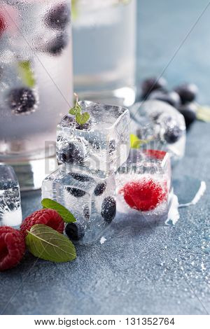 Ice cubes with raspberry, blueberry and mint
