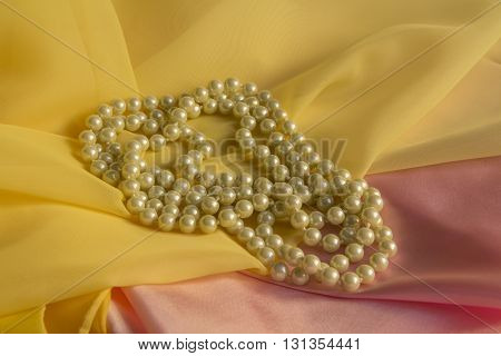 White Pearl Necklace with a Yellow and pink soft silk