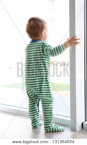 Little child on the windowsill