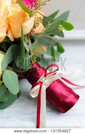 Beauty of colored flowers. Bridal accessories. Close-up bunch of ribbons. Details for marriage and for married couple. Wedding bouquet with ribbons