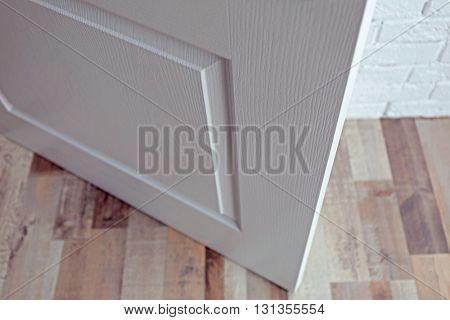 Part of white open door