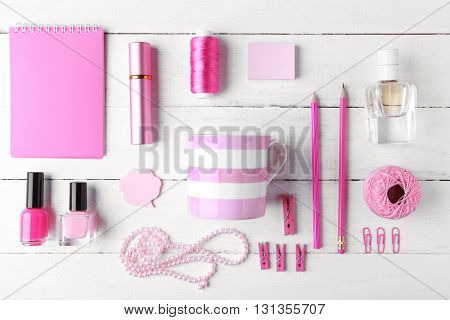 Pink colour flat lay composition on white wooden background