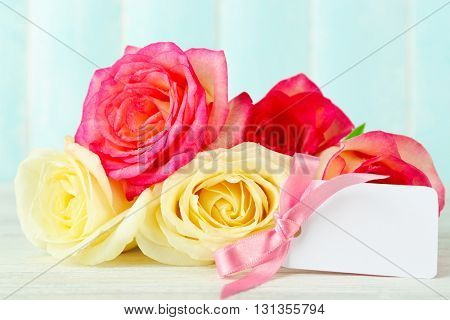 Happy Mother's day concept. Roses and empty card.