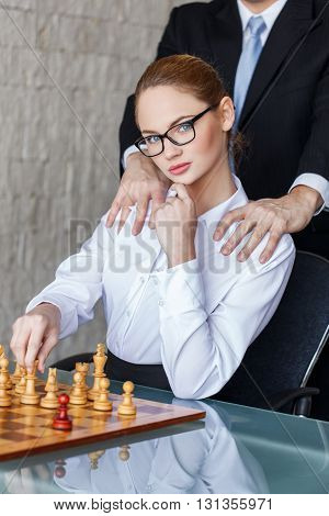 Boss grip secretary in office with chessboard secret relationship tactics