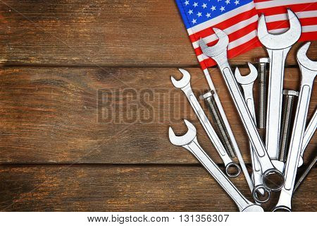 Different kinds of wrenches on a wooden background. Labor day concept.