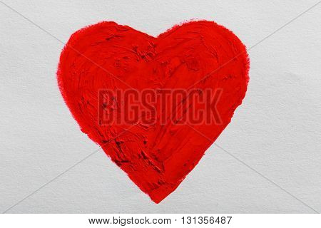 Red heart painted on light background