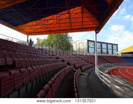 Plastic seating section on the covered grandstand of sport stadium